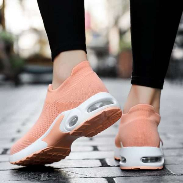 Women's thick-soled athletic shoe with increased comfort and cushioning
